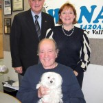 Dr. Arnold Roufa with pet.  Standing: Co-hosts Jonah Triebwasser, Sarah O'Connell