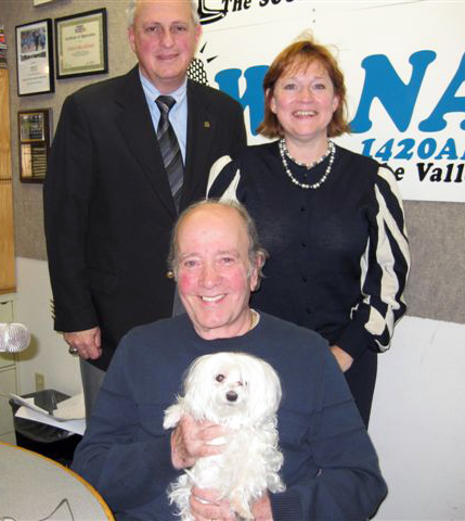 Dr. Arnold Roufa with pet. Standing: Co-hosts Jonah Triebwasser, Sarah