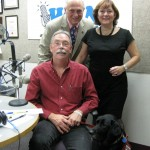 Seated: John Moon with Rainbow, a service dog. Standing: Co-hosts Jonah Triebwasser, Sarah O'Connell